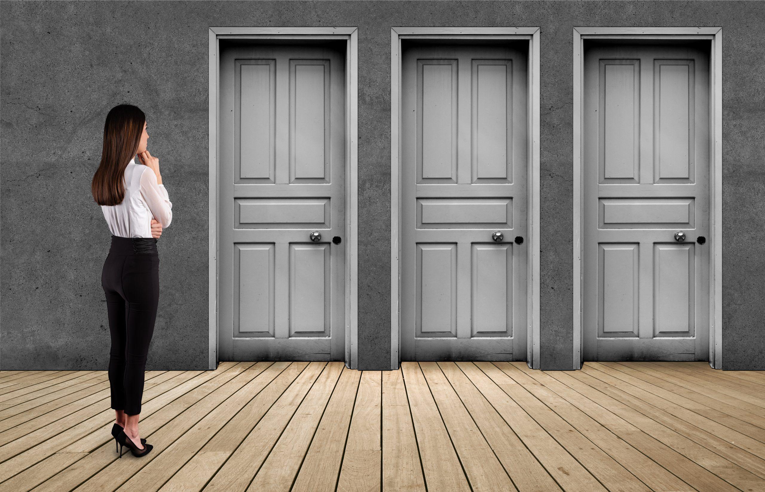 Business woman look at door.
